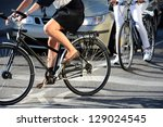 Woman on bicycle in traffic - stock photo