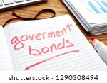 government bonds. notepad and... | Shutterstock . vector #1290308494
