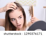 woman with hair loss problem... | Shutterstock . vector #1290376171