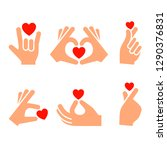 hands with red hearts  icons... | Shutterstock .eps vector #1290376831