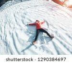 happy girl making the angel... | Shutterstock . vector #1290384697
