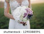 wedding bouquet in bride's hands | Shutterstock . vector #1290388591