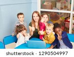 teacher and children with... | Shutterstock . vector #1290504997