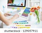 female designer working with...   Shutterstock . vector #129057911