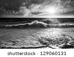Ocean Waves With A Sunburst An...