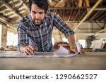 focused young woodworker... | Shutterstock . vector #1290662527