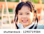 asian child girl playing on... | Shutterstock . vector #1290719584