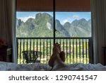 female 's feet relaxing on the... | Shutterstock . vector #1290741547