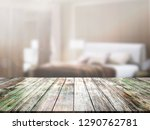 closeup top wood table with... | Shutterstock . vector #1290762781