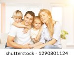 beautiful smiling family... | Shutterstock . vector #1290801124