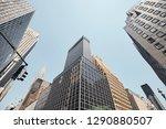 looking up at manhattan... | Shutterstock . vector #1290880507