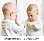 ten month boy stands before the ... | Shutterstock . vector #129088694