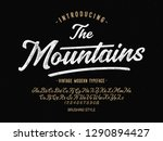 Stock vector  the mountains vintage brush script modern alphabet retro typeface vector font illustration 1290894427