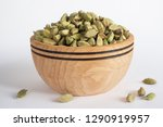 cardamom in a wooden bowl. | Shutterstock . vector #1290919957