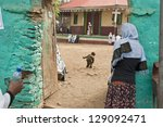 Small photo of GONDER, ETHIOPIA - MARCH 25: Unidentified Ethiopian woman prays in front of Tekla Haimonot's Orthodox Church during annual Abye Tsome (Great Fast) in Gonder, Ethiopia on March 25, 2012.