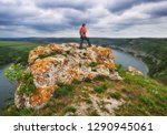 tourist on the rock. girl... | Shutterstock . vector #1290945061