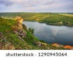 tourist on the rock. girl... | Shutterstock . vector #1290945064