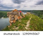 tourist on the rock. girl... | Shutterstock . vector #1290945067