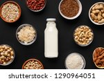 bowls with various nuts and... | Shutterstock . vector #1290964051