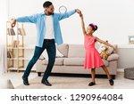 african american father dancing ... | Shutterstock . vector #1290964084