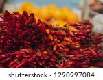 heap of ripe big red peppers at ... | Shutterstock . vector #1290997084
