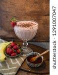 banana  strawberry and honey on ... | Shutterstock . vector #1291007047