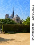 Notre Dame cathedral with park in Paris, France. - stock photo