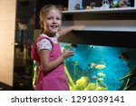 little girl child looks at the... | Shutterstock . vector #1291039141