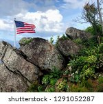 american flag blowing in a...   Shutterstock . vector #1291052287