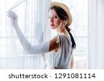 woman in white dress holding... | Shutterstock . vector #1291081114