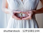 Woman Holding Old Key In A...