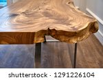 Live edge elm slab coffee table. Woodworking and carpentry production. Close-up. Furniture manufacture