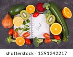 notepad and fresh ripe fruits... | Shutterstock . vector #1291242217