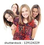 group of happy teen girls  over ... | Shutterstock . vector #129124229