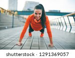 young woman exercises on the... | Shutterstock . vector #1291369057