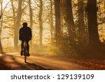 Silhouette Of A Biker In Autum...