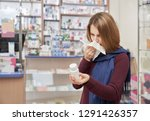 ill woman with flu standing in... | Shutterstock . vector #1291426357