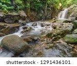 putri kencana waterfall at... | Shutterstock . vector #1291436101