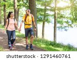 happy couple walking in the... | Shutterstock . vector #1291460761