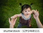 asian baby girl playing in the... | Shutterstock . vector #1291468111