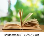 opened book on bright background | Shutterstock . vector #129149105