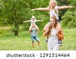 happy kids ride piggyback on a... | Shutterstock . vector #1291514464