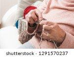closeup of grandmother's hands... | Shutterstock . vector #1291570237