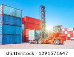 forklift trucks are handling at ... | Shutterstock . vector #1291571647