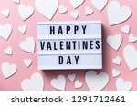 Stock photo happy valentin s day lightbox message with white hearts on a pink background 1291712461
