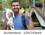 Stock photo backpacker arriving to a camping with his cat 1291743664