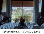 female 's feet relaxing on the... | Shutterstock . vector #1291791241
