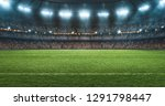 Small photo of Photo of a soccer stadium at night. The stadium was made in 3d without using existing references.