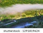 foggy spring morning.... | Shutterstock . vector #1291819624