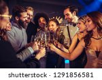 young people toasting in a... | Shutterstock . vector #1291856581